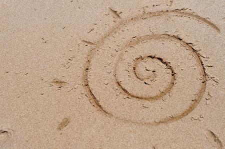 Sun symbol drawn on beach sand Stock Photo - 18824564