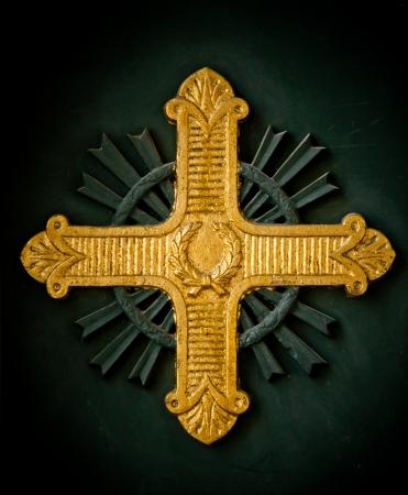 cross armed: Shining gold cross relief on a Greek Orthodox church in Istanbul, Turkey