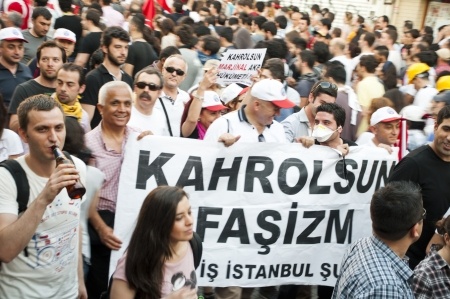 ISTANBUL, TURKEY - JUNE 1, 2013 : Gezi Park protests in Istanbul.Turkish protestors clash police under excessive use of violence and tear gas. A small demonstration turned into a national uprising