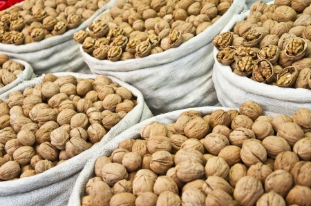 Row of bags full of walnuts photo