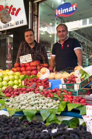 fruit trade: BURSA, TURKEY - 27 APRIL: Turkish men selling fresh fruits at the city bazaar named Reyhan Pazari in Bursa. 27 April 2013