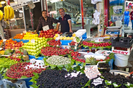 BURSA, TURKEY - 27 APRIL: Turkish men selling fresh fruits at the city bazaar named Reyhan Pazari in Bursa. 27 April 2013