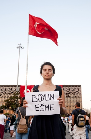 occupy movement: ISTANBUL, TURKEY - June 18 2013  Standing Man protest following the Gezi Park conflicts in Istanbul  People only stand still and silently to protest the government s actions  June 18 2013, Istanbul
