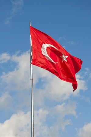 turkish flag: Large Turkish flag waving in the cloudy blue sky Stock Photo