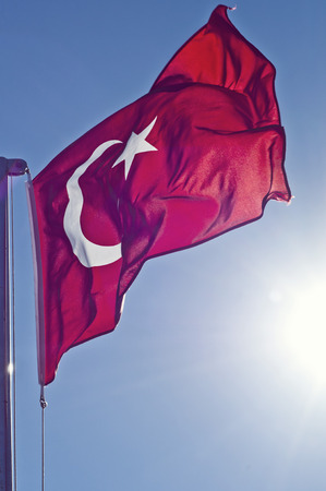 turkish flag: Turkish flag waving in the blue sky