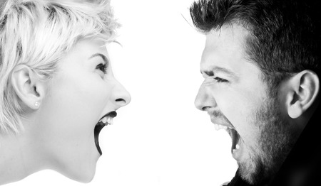 Young man and woman shouting at each other, relations concept photo