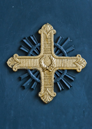 iron cross: Golden cross sign from a church