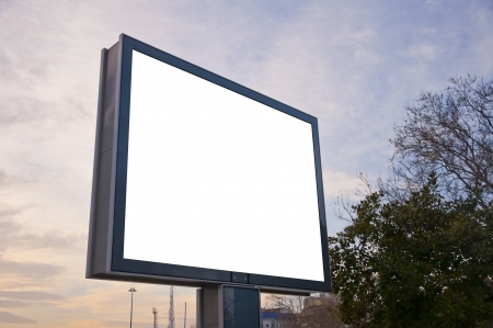 Blank billboard in the city with sunset sky background photo