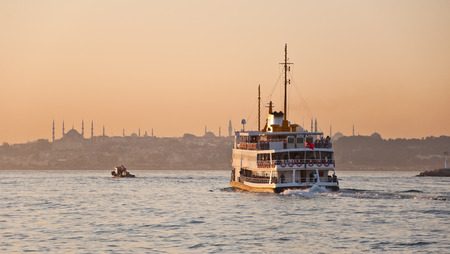 JAN 13 - ISTANBUL, TURKEY  Istanbul inner line steamboat heading from Asian side to the European in the sunset background, taken on January 13, 2014 Stock Photo - 25620618