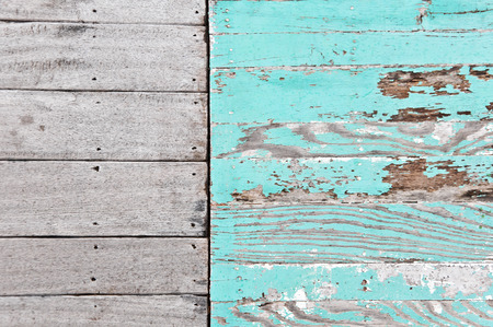 Grungy wooden panels with peeled paint layer photo