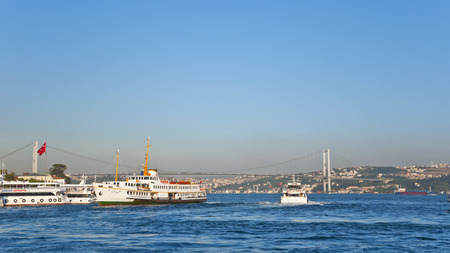 JAN 13 - ISTANBUL, TURKEY  Public ferries standing at and taking off from Kabatas station for the intercontinental journey between Europe and Asia, taken on January 13, 2014