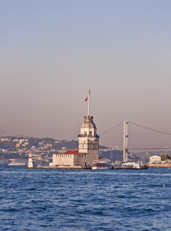 JAN 30, 2014 - ISTANBUL, TURKEY   The Maidens Tower and the Bosphorus Bridge view in the sunset, Istanbul - Turkey
