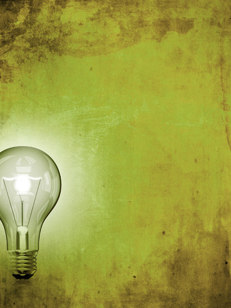 A light bulb on grunge paper background, idea and creativity concept photo
