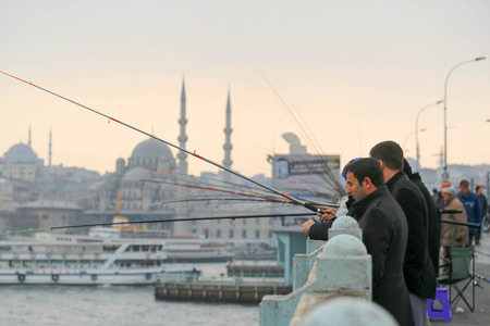 People fishing on the bridge in Istanbul