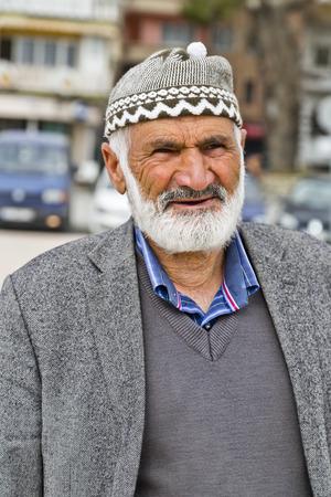 turkish man: BURSA - MARCH 10   Portrait of an oldery Turkish man on the street on March 10, 2014, Bursa, Turkey Editorial