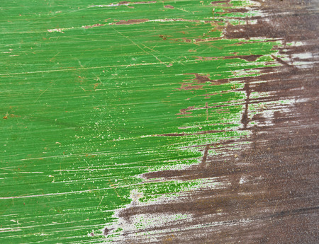 corrosion: Green painted scratched metal surface
