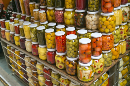 Lots of jars of pickles sold at a public market photo