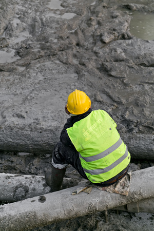 Worker giving a break in a construction area photo