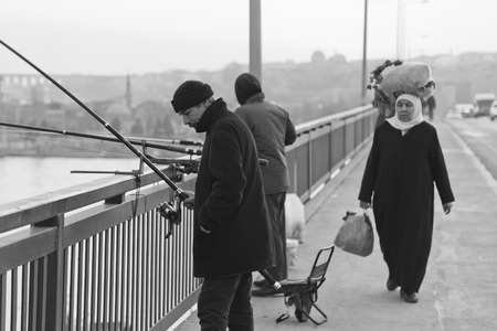link building: People fishing on the bridge in Istanbul