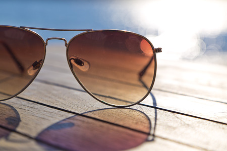 Sunglasses on the wooden table accessories photo