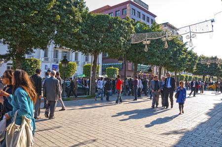 Tunisian people walking around in Habib Bourguiba Street, Tunisia