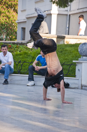 stage performer: Young people performing street dance at Heykel Square, the centre of Bursa city, Turkey