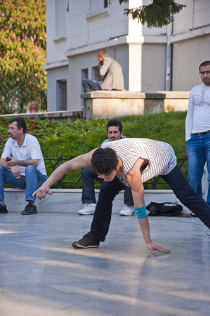 foot girl: Young people performing street dance at Heykel Square, the centre of Bursa city, Turkey