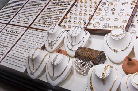 Golden accessories in a jewellery store display window photo