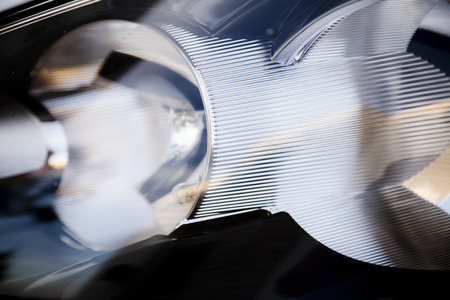 Close-up view of a car headlight photo