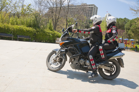 patrolling: ISTANBUL, TURKEY - MAY 28, 2014  Two Turkish police officers riding a motorcycle, patrolling for security in Macka Park, Istanbul on May 28, 2014 Editorial