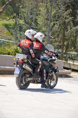 polis: ISTANBUL, TURKEY - MAY 28, 2014  Two Turkish police officers riding a motorcycle, patrolling for security in Macka Park, Istanbul on May 28, 2014 Editorial