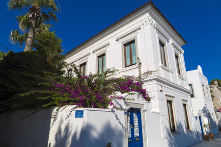 mediterranean house: Detail from Bodrum architecture, whitewashed houses with usually blue or colorful windows  Bodrum is a popular summer destination in Turkey,
