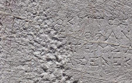 Stone texture with ancient Greek scripts