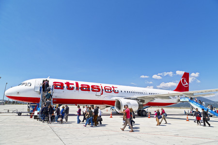 passenger aircraft: Bodrum, Turkey - APRIL 15, 2014: Atlasjet airplane boarding at Bodrum-Milas International Airport. Bodrum-Istanbul domestic line on April 15, Turkey