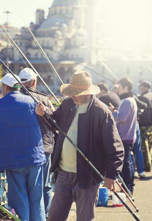 People fishing on the bridge in Istanbul