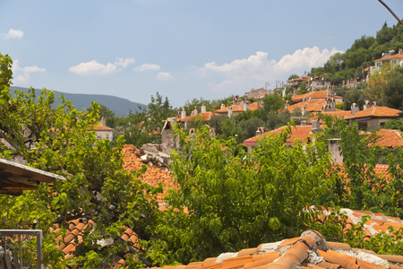 MUGLA, TURKEY - JULY 21: View from Mugla city with genuine Anatolian houses and traditional chimneys in the old town on July 21, 2014
