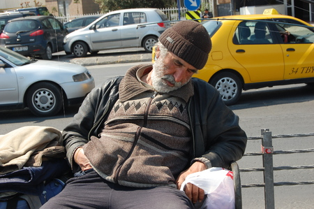 Sleeping beggar man in Istanbul Editorial