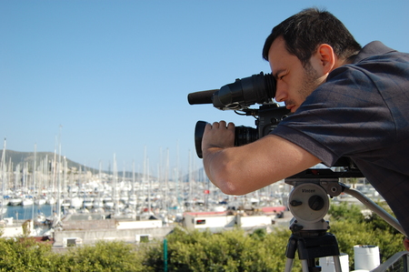 outside shooting: Young cameraman at video shooting outside in Bodrum, Turkey