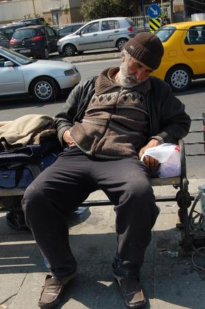 beggary: Sleeping beggar man in Istanbul Editorial