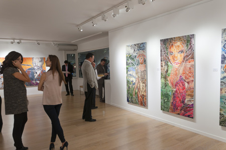 art thinking: ISTANBUL, TURKEY - JAN 13, 2012: Opening night of Pinar du Pre art exhibition at Linart Gallery on January 13. Editorial