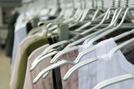 large group of items: Hanging clothes at a store