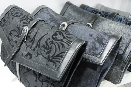 Black purses in a row photo