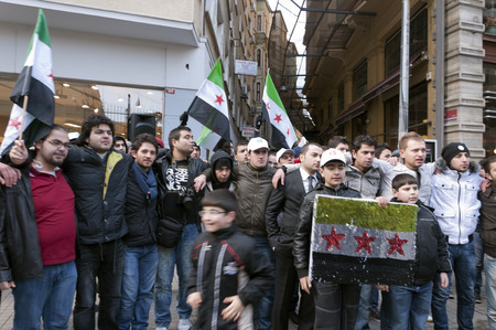 al assad: ISTANBUL, TURKEY - JAN 29: Syrians inhabiting in Turkey are marching for peace and freedom in Syria in Istiklal Avenue, Istanbul on January 29, 2012 Editorial