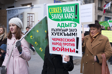 backlash: ISTANBUL, TURKEY - JAN 29: Circassian people living in Istanbul are marching for the safety and human rights of the Circassians in Syria with banners and slogans on January 29, 2012
