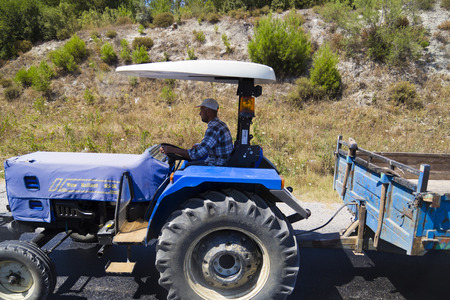 asphalting: Turkish villager driving a tractor Editorial