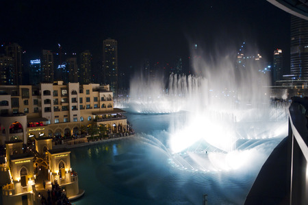 DUBAI, UAE - FEB 23 2012: record-setting fountain system set on Burj Khalifa Lake, 6600 lights and 25 projectors, shooting water 150m into the air, on February 23, 2012 in Dubai, United Arab Emirates