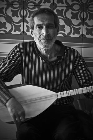 saz: Turkish man playing baglama in the street