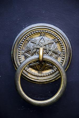 ornate door: Brass ornate door knocker Stock Photo