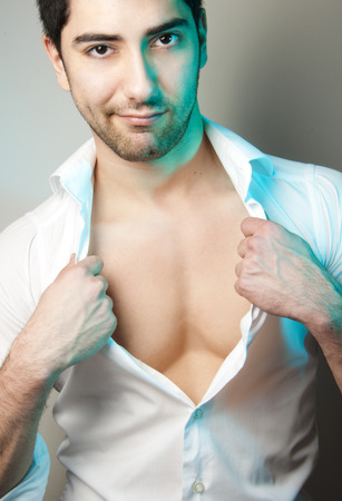 Young attractive man with white shirt photo