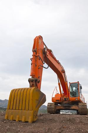 dredging tools: Orange excavator